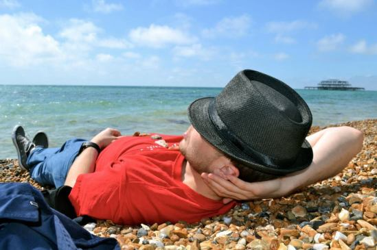 "Me, on a beach somewhere ""exotic"" like the UK"